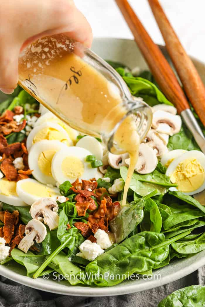 Spinach Salad Dressing poured over salad