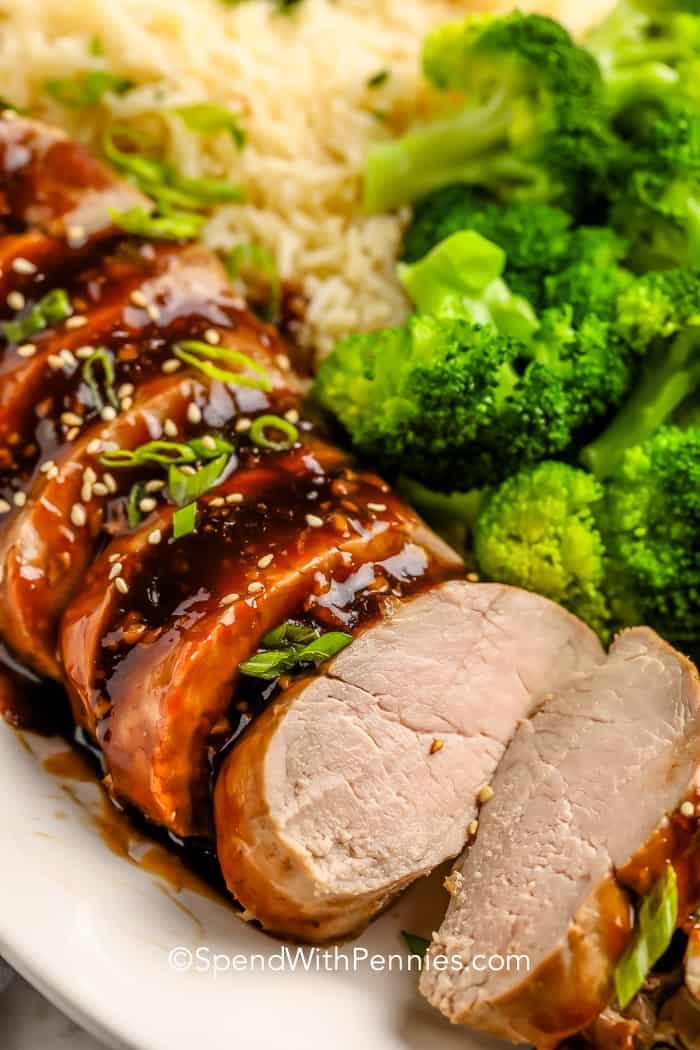 Teriyaki Pork Tenderloin on a plate with broccoli and rice