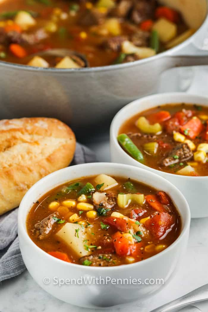 bowls of Vegetable Beef Soup with a pot full in the background