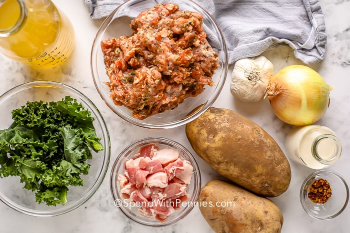 Zuppa Toscana ingredients on a marble board