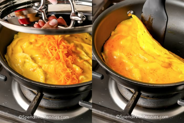omelette cooking in a pan with a lid and a spatula