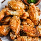 Air Fryer Chicken Wings on a plate with garnish