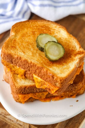 plated Air Fryer Grilled Cheese with pickle slices on top
