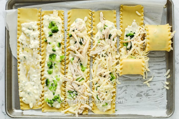 process of rolling Chicken Lasagna Roll Ups