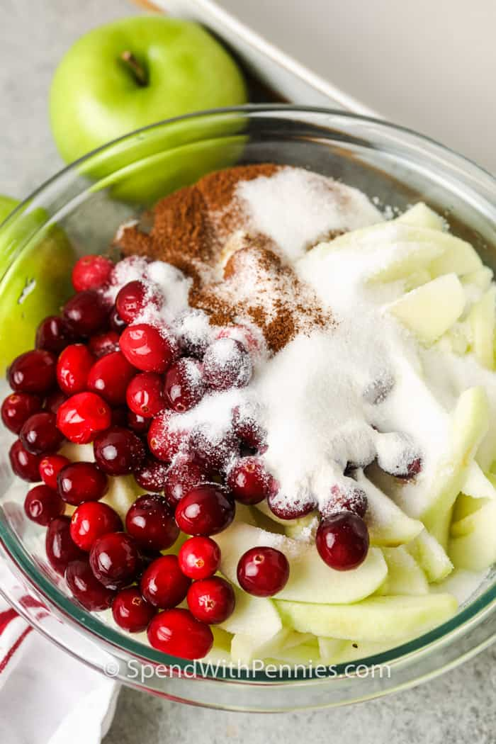 ingredients to make Cranberry Apple Crisp in a glass bowl