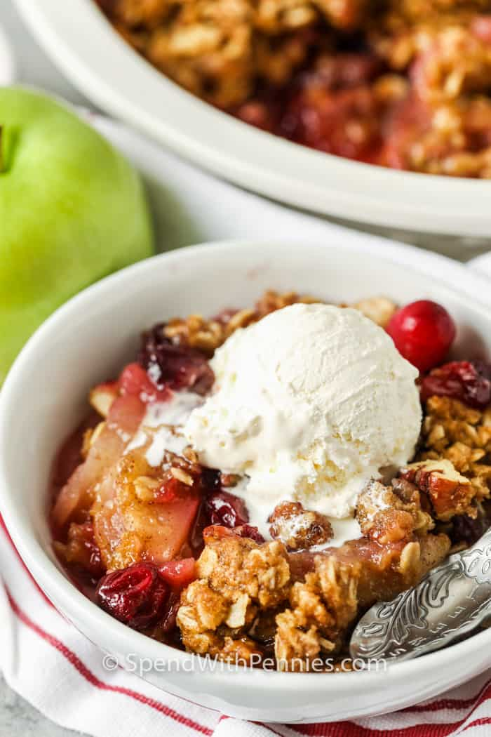 Cranberry Apple Crisp in a bowl with ice cream on top