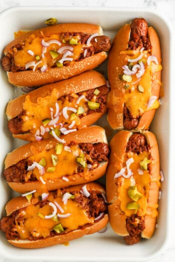 six Chili Cheese Dogs cooked in a casserole dish