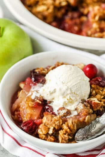 close up of Cranberry Apple Crisp in a white bowl
