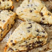 close up of cooked Mini Chocolate Chip Scones on a baking sheet