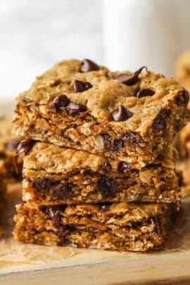pile of Peanut Butter Oatmeal Bars with gooey chocolate chips