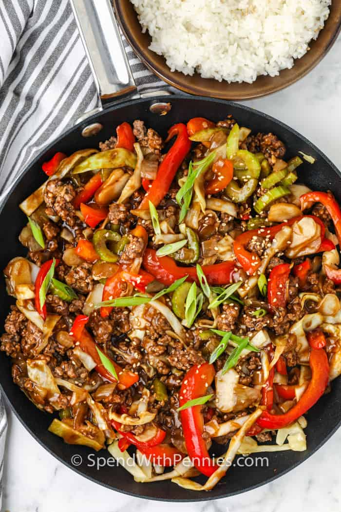 top view of cooked Ground Beef Stir Fry in the pan with a side of rice