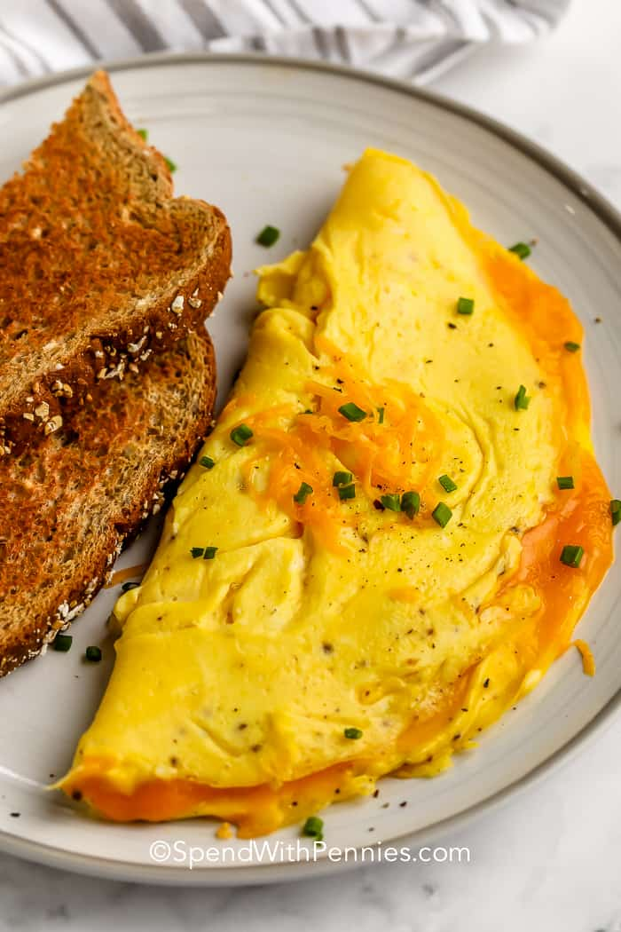 Omelette on a plate with toast for How To Make A Omelette
