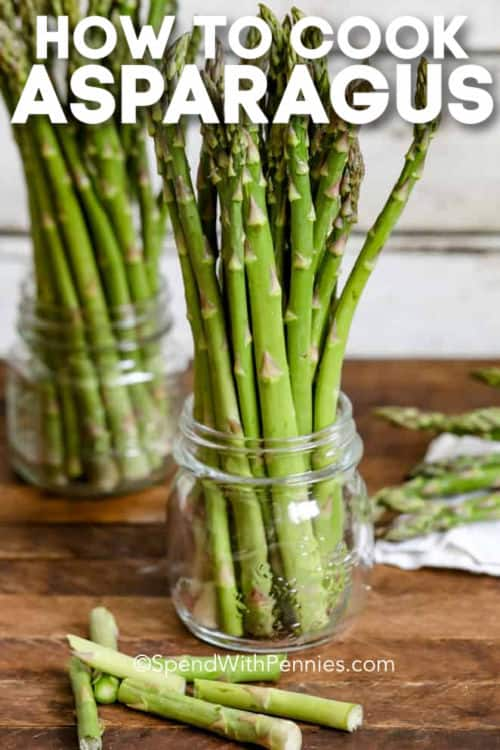 cut up asparagus in jars with writing to show How to Cook Asparagus
