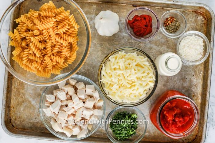 ingredients on a baking sheet to make One Pot Rotini Pasta