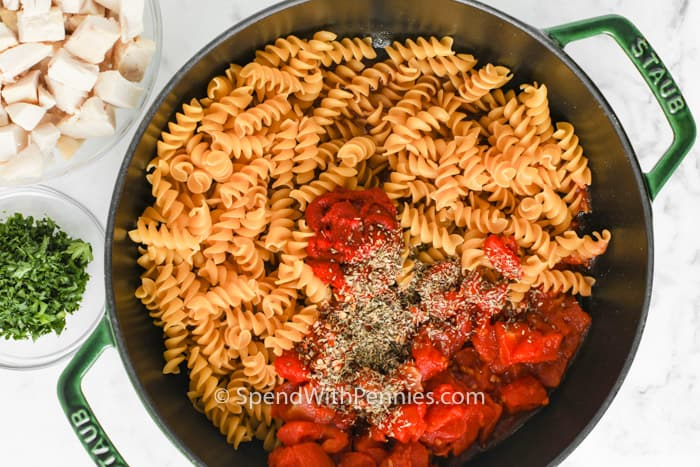ingredients in the pot to make One Pot Rotini Pasta