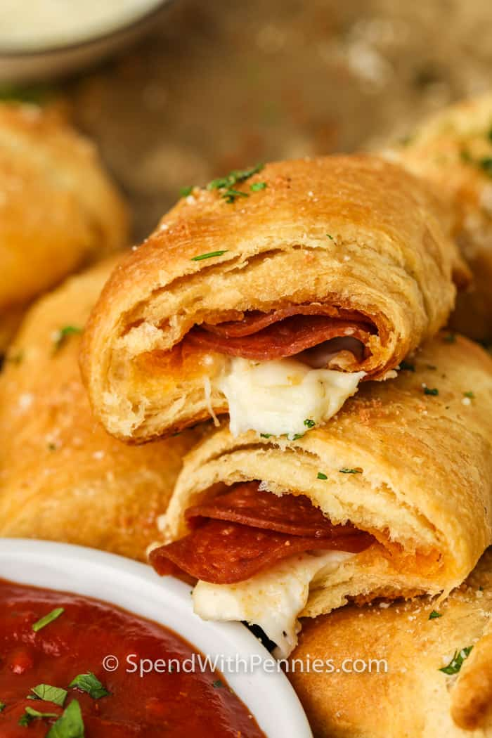 Pepperoni Pizza Crescent Rolls with a bowl of dip