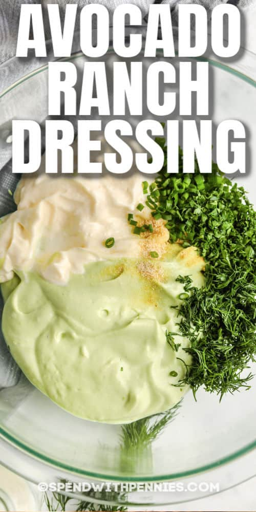 ingredients to make Avocado Ranch Dressing in a glass bowl with writing