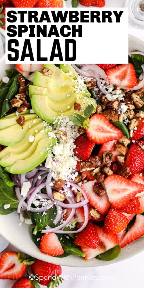 Strawberry Spinach Salad in a white bowl with a title.
