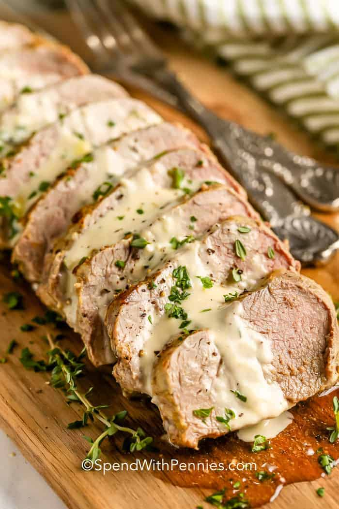 pork tenderloin with sauce overtop