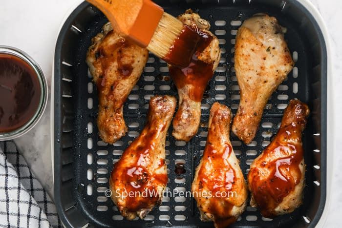brushing sauce on Air Fryer Chicken Drumsticks