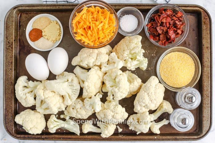 ingredients to make Bacon Cheddar Cauliflower Tots on a baking sheet