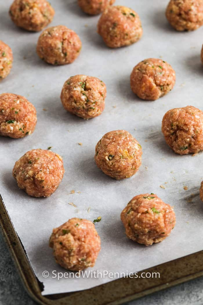 Chicken Meatballs on a baking sheet before cooking