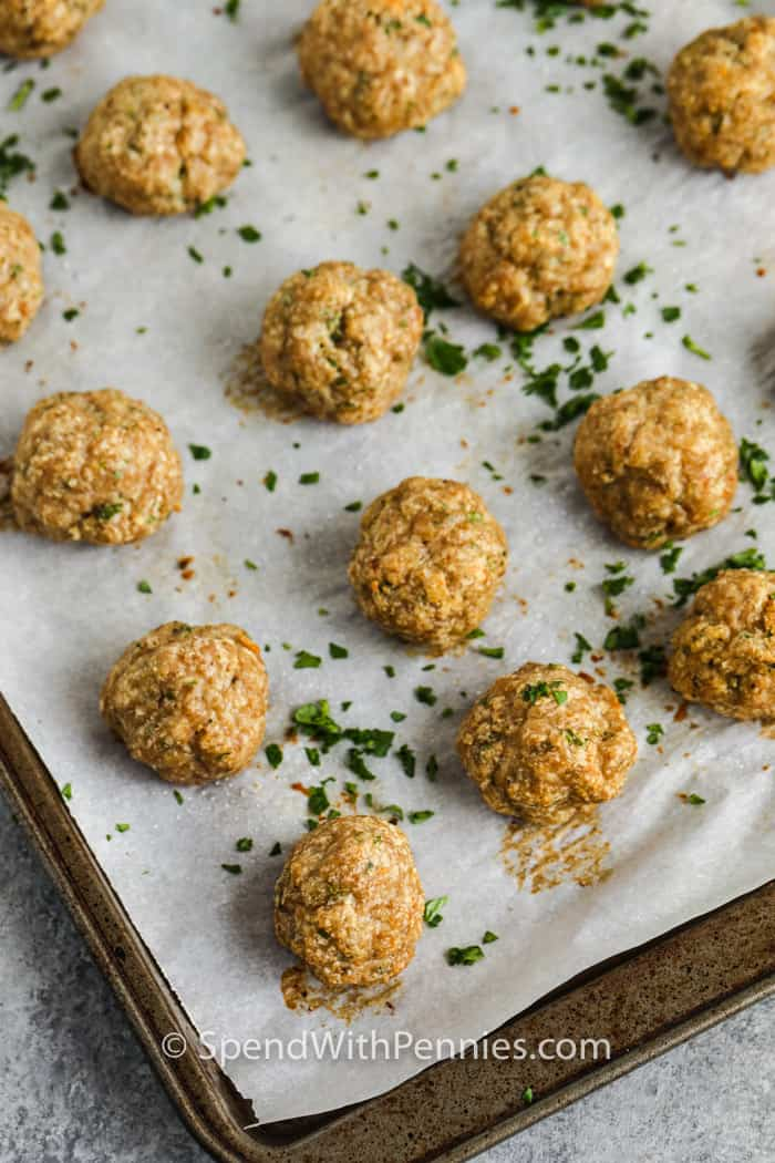 cooked Chicken Meatballs on a baking sheet