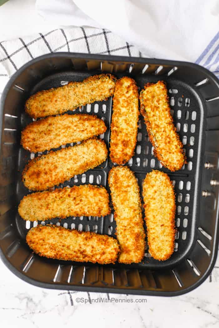 fried pickles in an air fryer basket