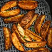 cooked and seasoned Air Fryer Potato Wedges in the air fryer