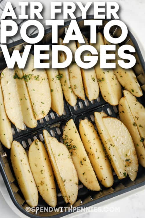 Rosemary Air Fryer Potato Wedges cooking in the air fryer with writing
