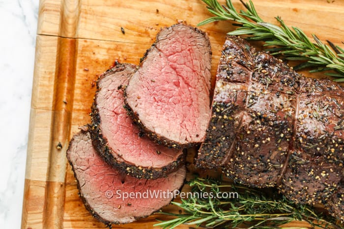 slices of Roast Beef Tenderloin on a cutting board