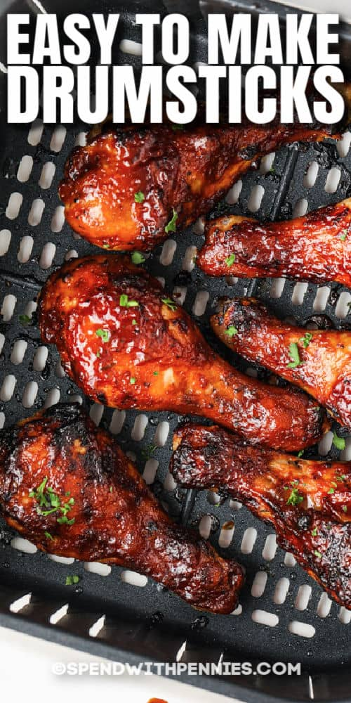 Air Fryer Chicken Drumsticks in the air fryer with writing