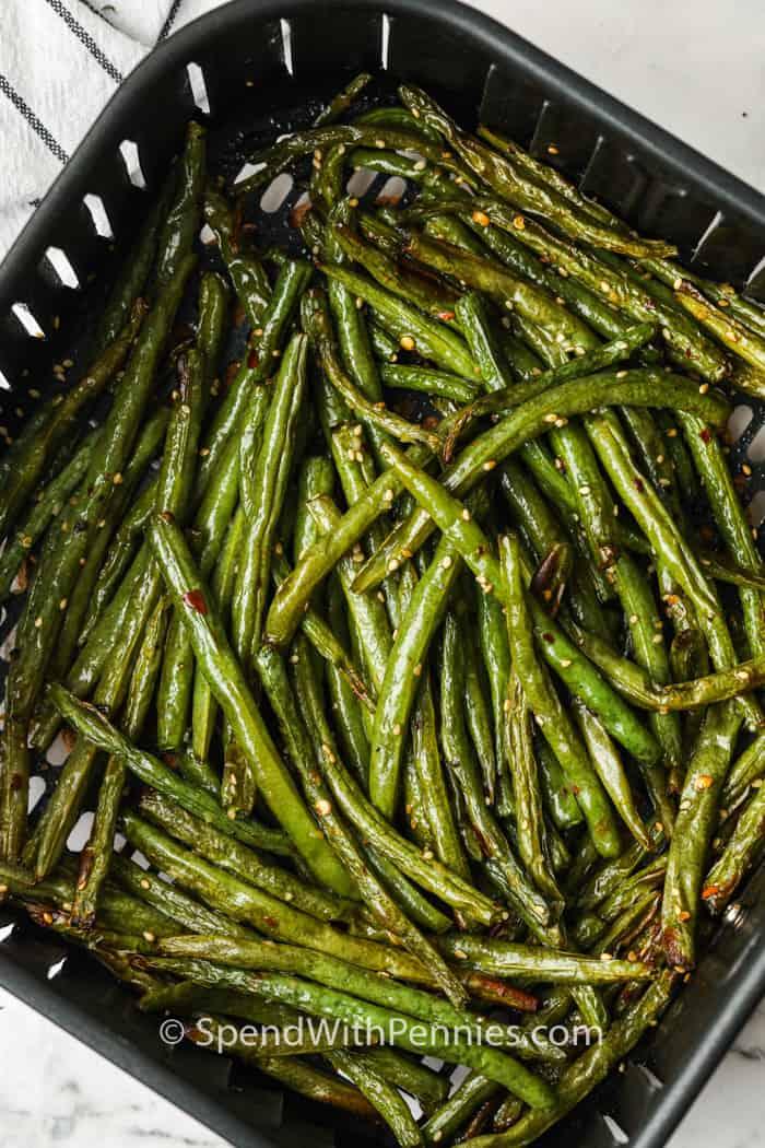 Sesame Air Fryer Green Beans seasoned in the air fryer
