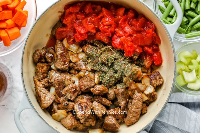 Browned beef and tomatoes in a pot