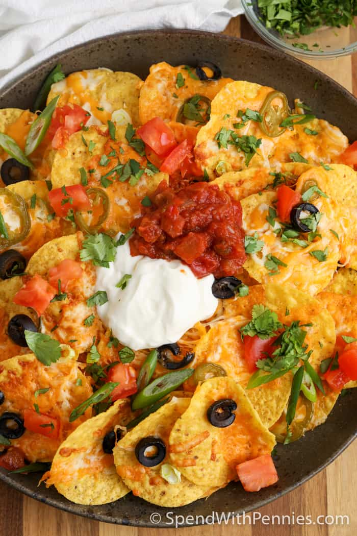 Air Fryer nachos on a plate with sour cream