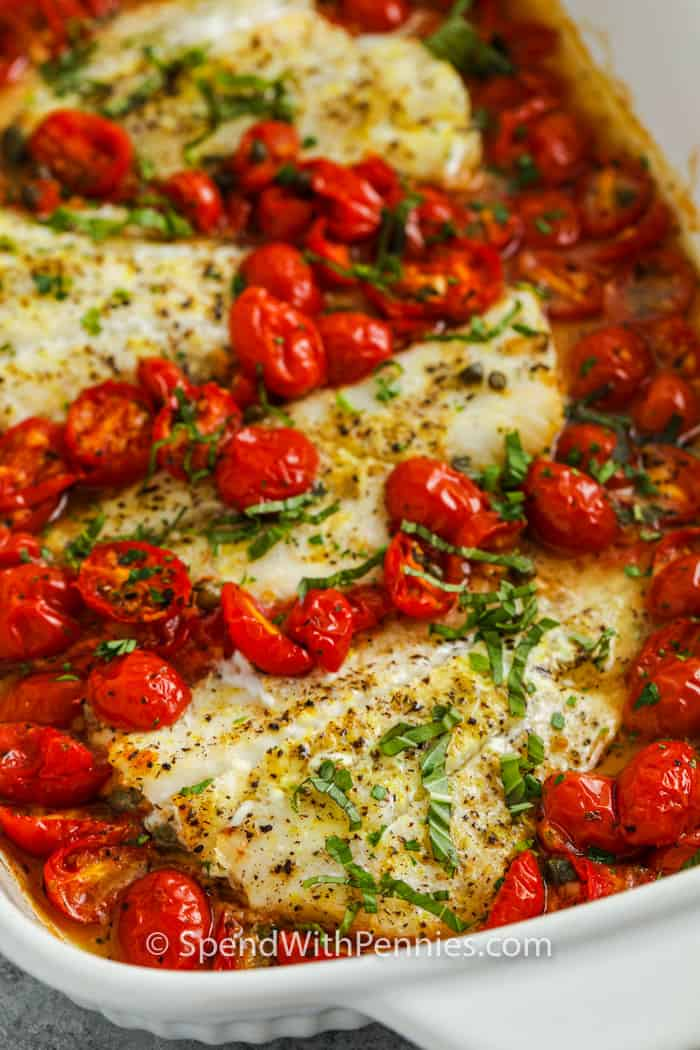 close up of cooked Baked Cod with Tomatoes & Capers in a pan