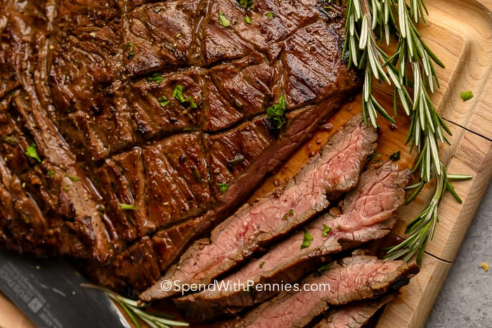 Balsamic Marinated Flank Steak on a wooden board
