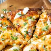 close up of slices of Buffalo Chicken Pizza with dressing