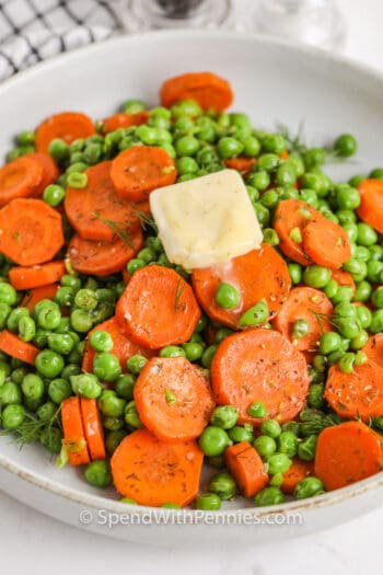 Buttery Peas and Carrots with melted butter