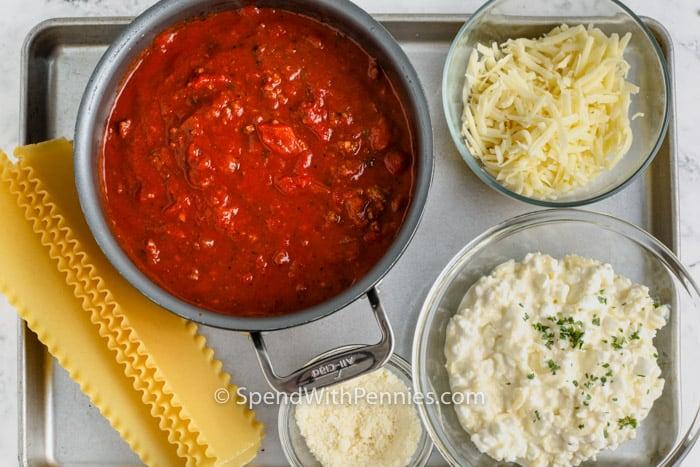 Crock Pot Lasagna ingredients in bowls