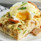 close up of Eggs Benedict Casserole with an egg