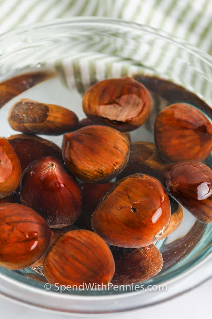 chestnuts soaking in water to make Roasted Chestnuts