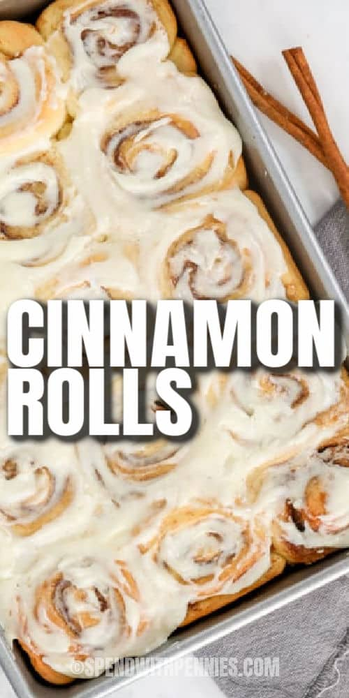 Homemade Cinnamon Rolls in the baking tin with a title