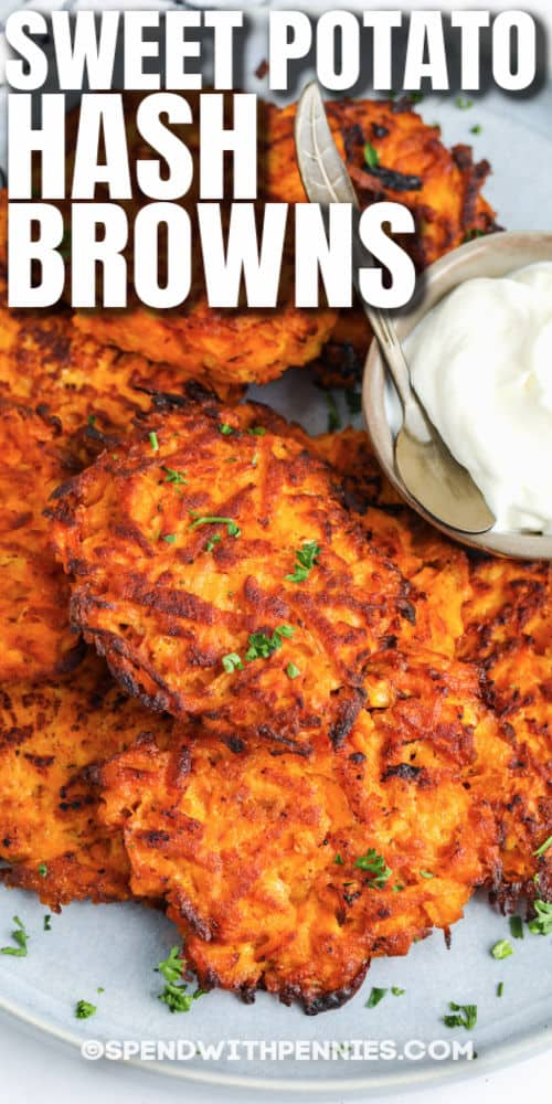 Sweet Potato Hash Browns on a plate with sour cream and a title