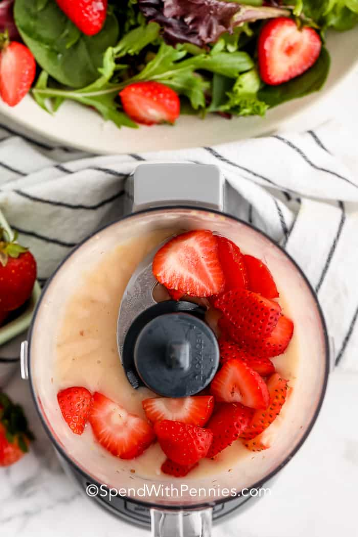 strawberries in a food processor for Strawberry Salad Dressing
