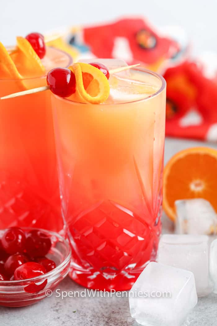 glasses of Tequila Sunrise with orange and cherry garnish