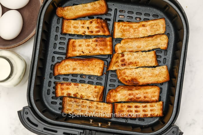 top view of cooked Air Fryer French Toast Sticks in the fryer