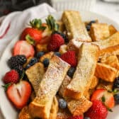 plated Air Fryer French Toast Sticks with berries