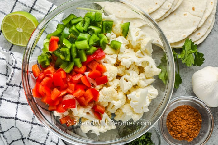 ingredients in bowls to make Cauliflower Tacos