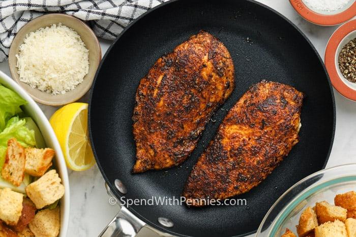 cooking chicken to make Chicken Caesar Salad